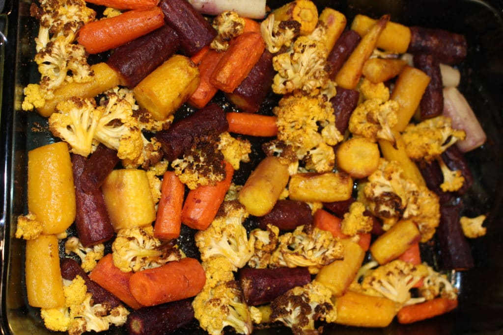 AIP Paleo Roasted Rainbow Carrots & Cauliflower is a simple delicious side dish to compliment any dinner. It's Whole 30, gluten free & vegan too. So easy. #aip #paleo #whole30 #glutenfree #vegan #sidedish #sides #recipe #easy #thehealthnutmama