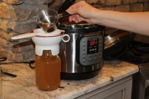 How to make Bone Broth in the Instant Pot - www.thehealthnutmama.com