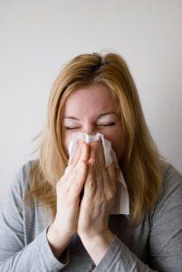 woman sick allergies - Leaky Gut