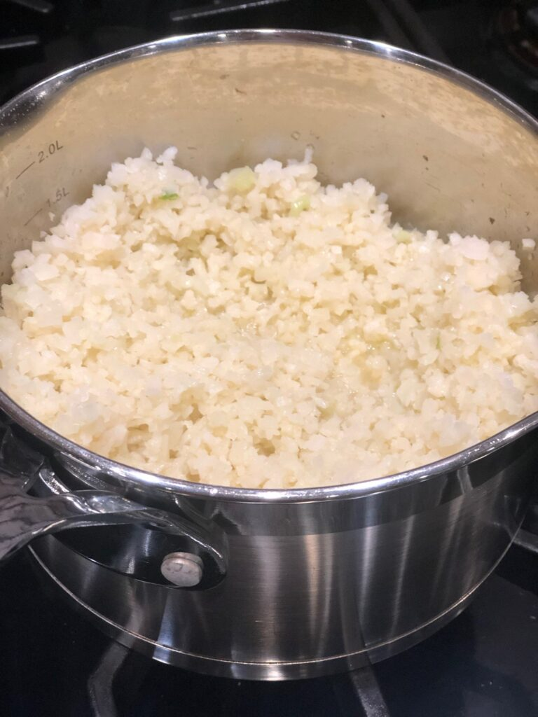 Learn how to make Cauliflower Rice. It is a quick, delicious, low carb, grain free, gluten free AIP Paleo alternative to Rice. In fact, I prefer it to Rice. Whole 30 & keto too! #aip #paleo #whole30 #lowcarb #keto #grainfree #glutenfree #caulirice #cauliflowerrice #cauliflower #ricealternative #thehealthnutmama