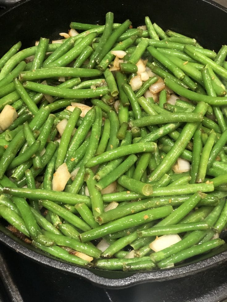 Paleo AIP Sauteed Garlic Green Beans are easy & delicious. Can be made in about 10 min. or less. A healthy low carb alternative to french fries. Salty & Crispy! #aip #aipfriendly #paleo #whole30 #lowcarb #keto #greenbeans #garlic #thehealthnutmama