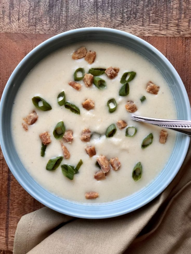 This Paleo Cauliflower Soup is so easy to make & delicious. It is AIP friendly, Whole 30, & Low Carb. #aipfriendly #aip #paleo #whole30 #lowcarb #veganfriendly #soup #cauliflower #thehealthnutmama