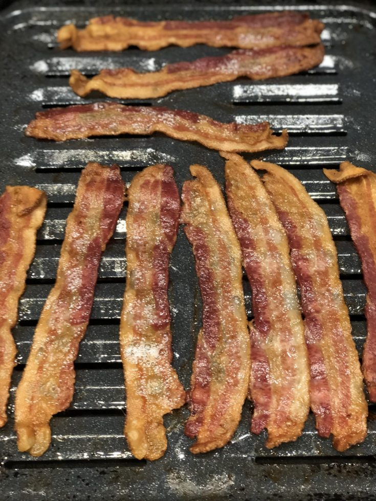 Learn How to Cook Bacon in the Oven without all the mess. The only way I will cook it anymore. Cook it in the oven while you are making the rest of your breakfast. Takes about 20 min. depending on how crispy you want it. #aipbacon #bacon #ovenbakedbacon #aipbreakfast #paleo #paleobacon #aip #paleobreakfast #whole30 #keto #lowcarb #howto #thehealthnutmama
