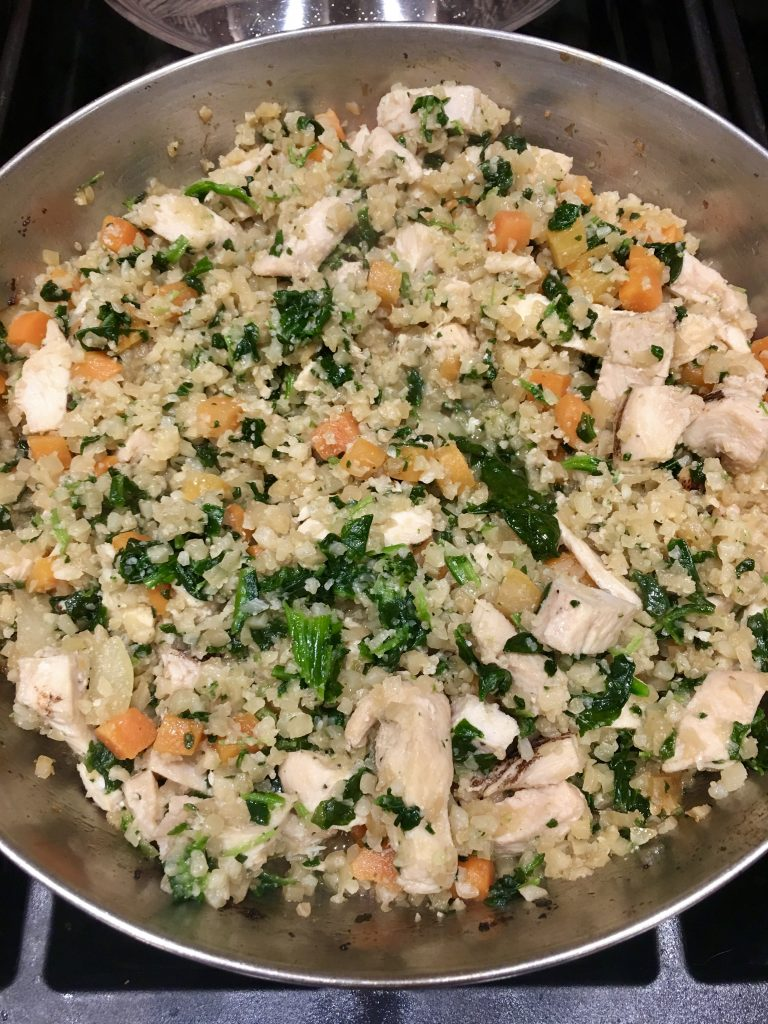 This Paleo AIP Chicken Fried Rice is a so easy to make healthy & delicious! Kids love it! Perfect for a quick weeknight dinner & to take for lunch in a thermos for school or work. A low carb alternative to Regular Chicken Fried Rice. #aip #paleo #aipdinner #paleodinner #whole30 #keto #lowcarb #chickenfriedrice #chickenrecipe #friedrice #asian #thehealthnutmama